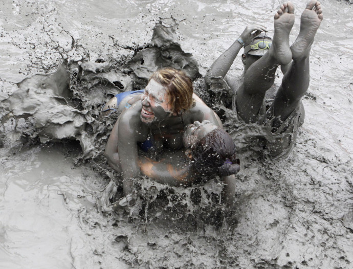 Tourists play in mud during the opening day of the Boryeong Mud Festival at Daecheon beach in Boryeong
